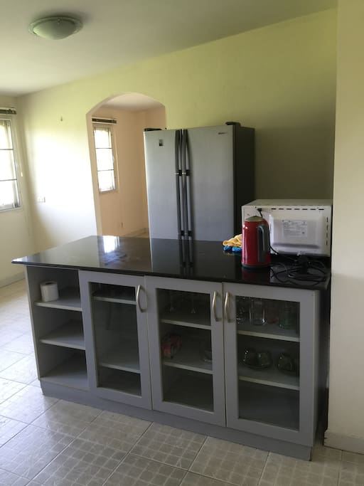 Big kitchen with all fridge, microwave, and more