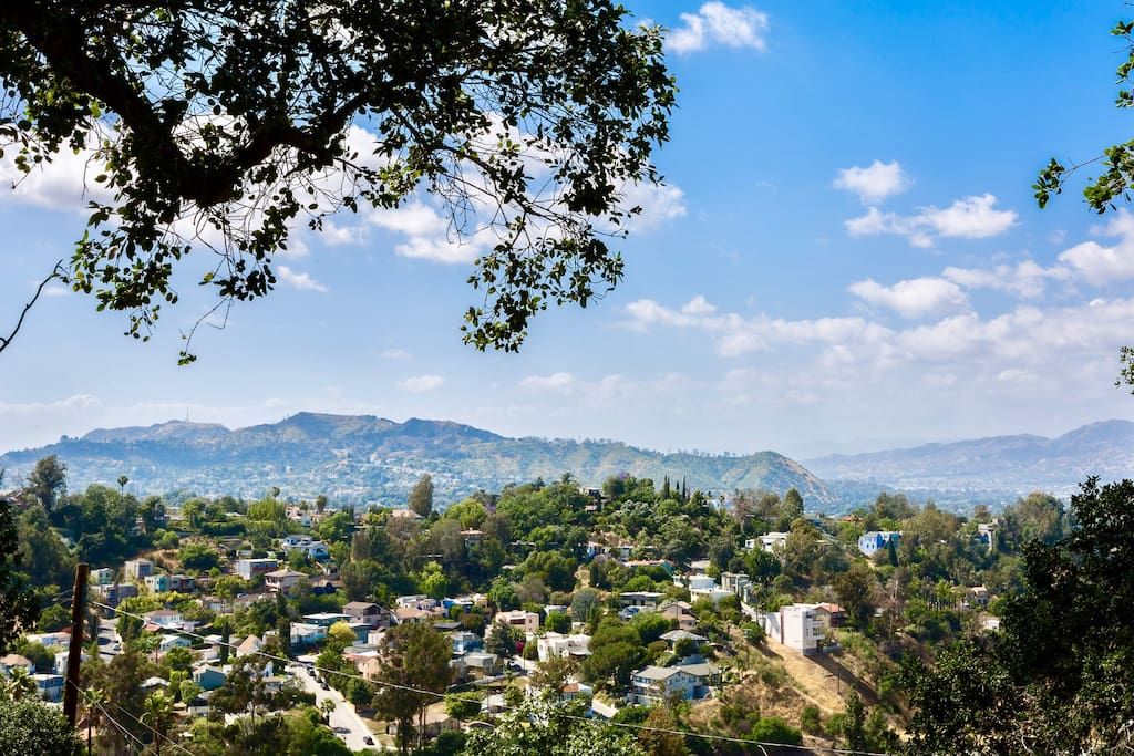 View from lower patio include views of Hollywood Sign, Griffith Park Observatory and Silverlake.