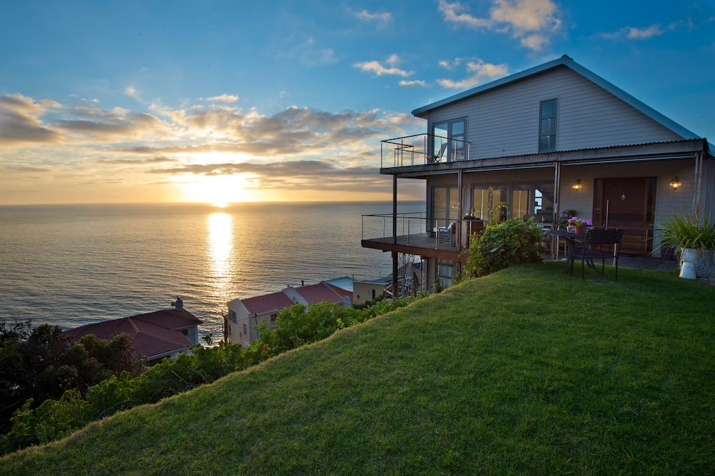 Soulmate, our 3 storey house perched on the mountain with breathtaking views of False Bay. The apartment is on the first floor.