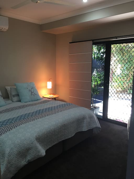 Main large bedroom has built in robes, glass sliding door to outside area.