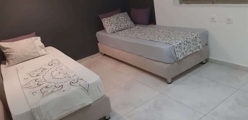 Option 2 for two guests: Double bed, can be split to two single beds.  Clean sheets, covers,  and towels, are provided.