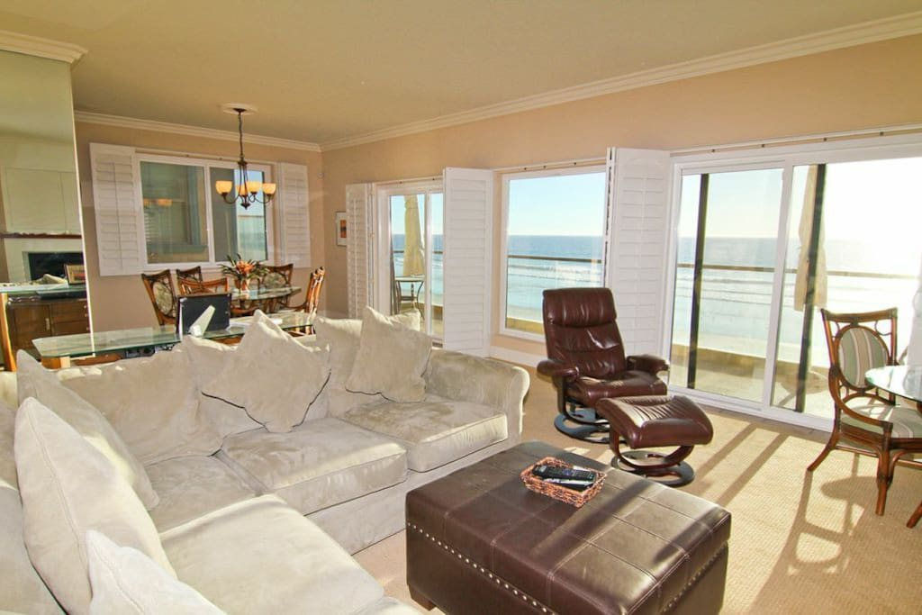 living room and dining space with beach view