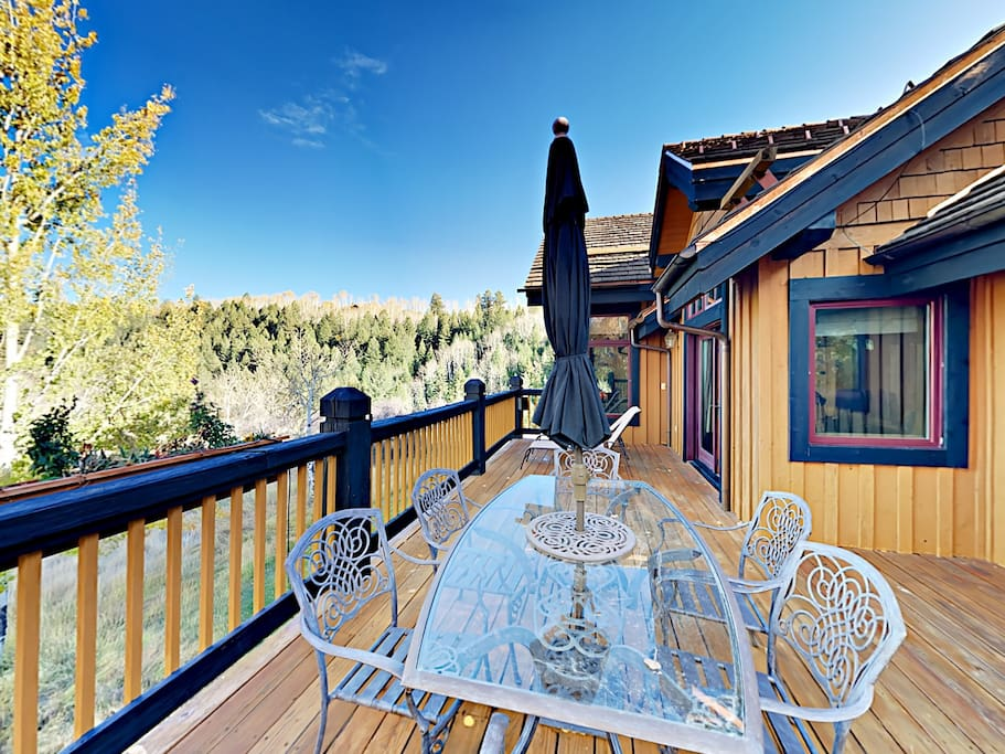 Dine al fresco on the balcony with views of the gorgeous Vail Valley.