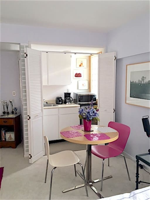 Dining area (with kitchenette doors open).