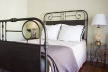 Bedroom 1: queen bed. Another view