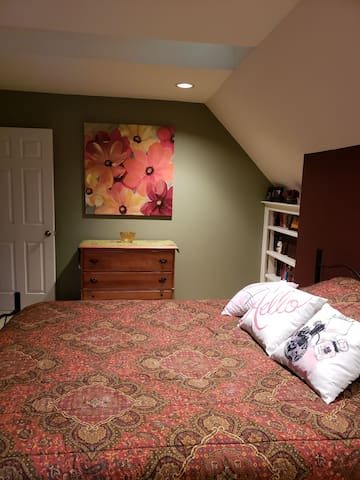 Incredibly comfy bed with extra pillows. Room has plenty of chest space and books to read!