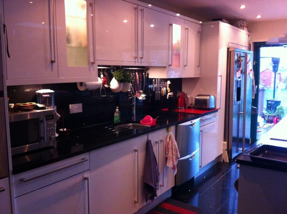 Open plan Kitchen with American style fridge