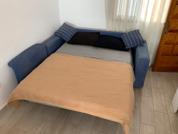 King size sofa bed in shared apartment