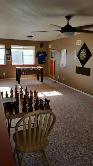 FAMILY GAME ROOM WITH FOOSBALL, DARTS, AND GIANT CHESS BOARD