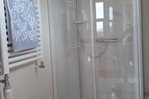 A shower, in the bathroom. The hot water is geothermal and is moved to the house through pipes from a borehole at Laugar, 3km south of my house.