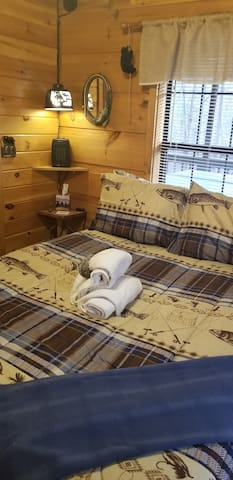 The other bedroom is located on the opposite side of the cabin offering privacy for couples traveling together.  It has a unique hanging bear lamp and is close to the bathroom.  It is the Master bedroom to us as it is slightly larger.