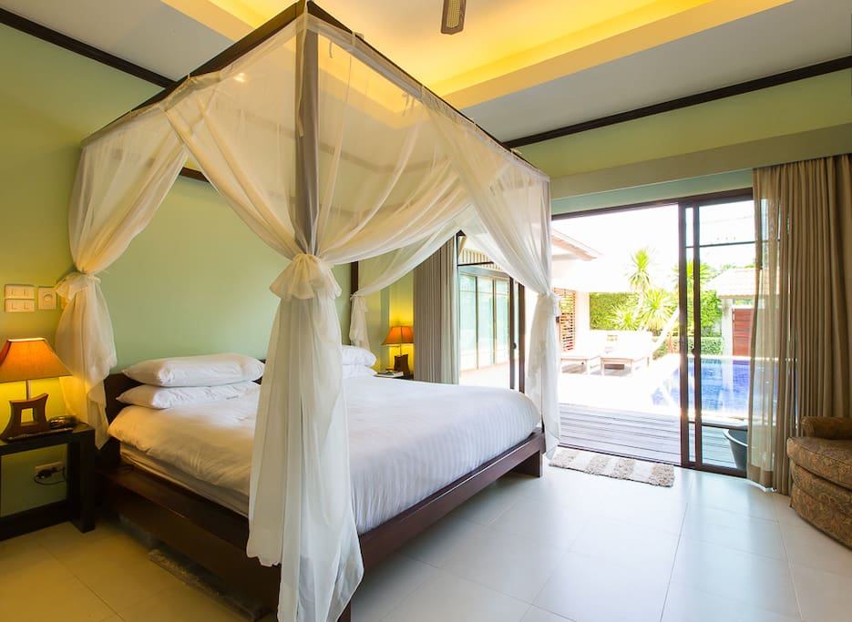 Master bedroom with direct access to  your private pool, air conditioning, overhead fan, in-room suite, duel interior lit clothing closets, safe, flat panel T.V. et al...