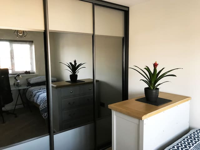 Large well-appointed single room, with desk and storage