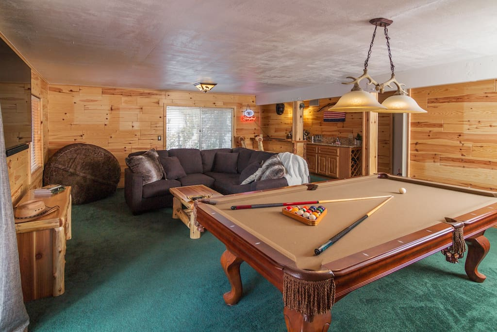 "Big spacious game room with wet bar, pool table, dart board, and 70"" TV!"