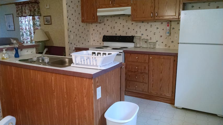 Full kitchen with dinerware, cookware.