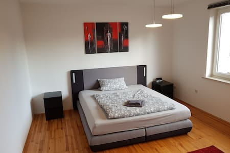 Big room with design bed an smart TV