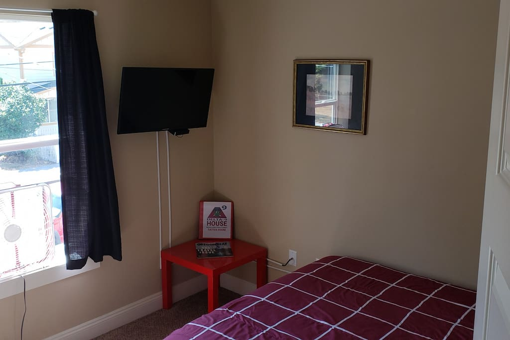 Sativa Room is 9' x 10' and and features air conditioning, high-speed wi-fi, TV with Amazon FireTV,  and a south-facing window that opens wide. The room also has a locking door with your own room key on a red carabiner.