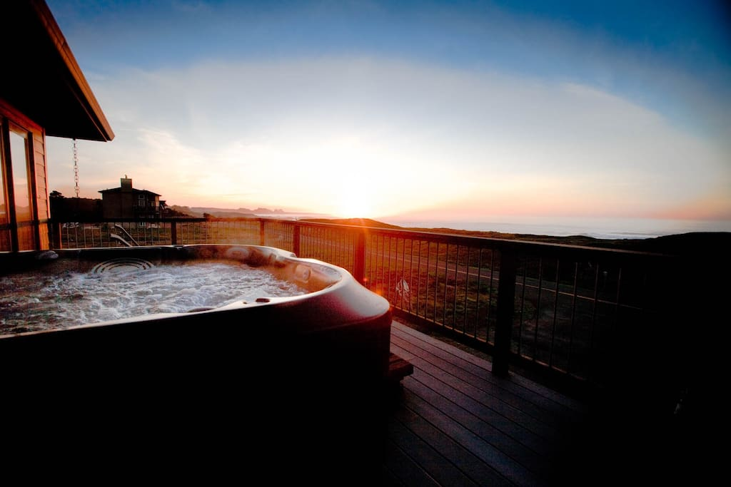The hot tub at sunset or under the stars is the most popular feature of the home.