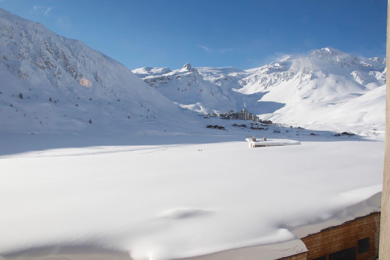 view of Tignes Val Claret, Glacier Grand Motte & frozen lake to the right hand side