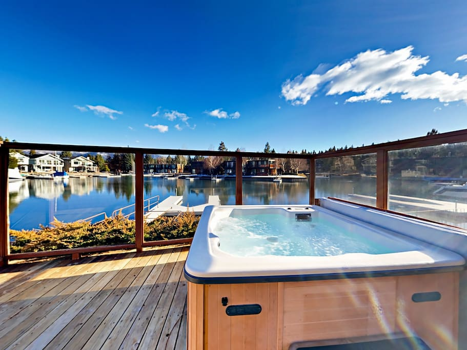 Take in expansive mountain views from the private hot tub.