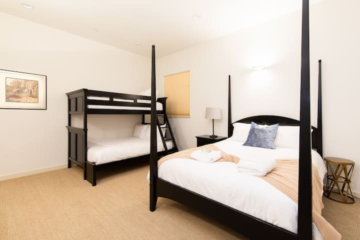 Bedroom #4 features Two Queen Beds and One Twin Bed