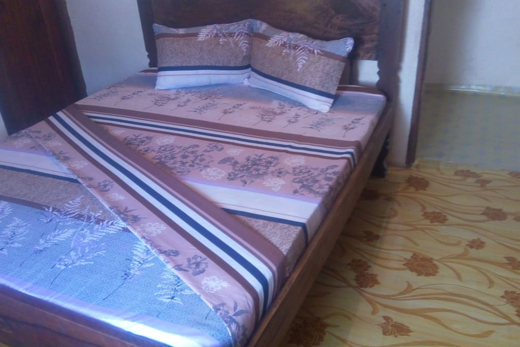 Queen size bed for bedroom one.