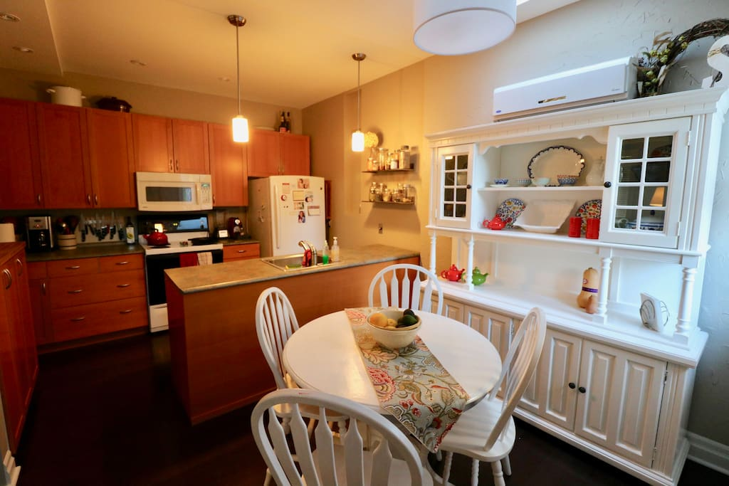 Well equipped kitchen with all major appliances (fridge, stove, dishwasher, etc.) and dining room.