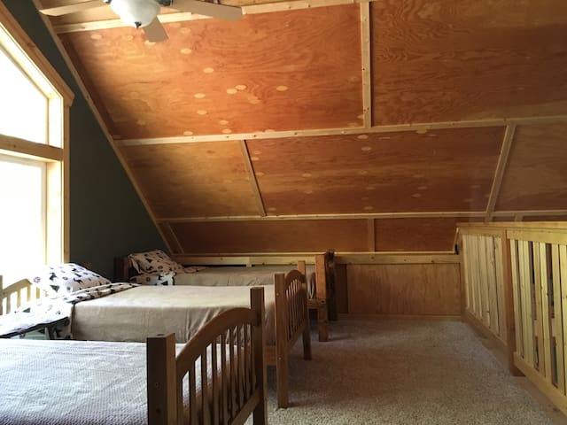 East loft with 4 twin beds.