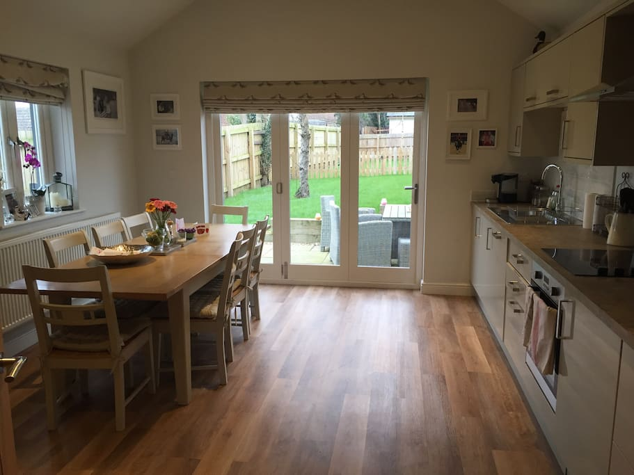 The kitchen leads into the garden and has a large table that seats 8, a dishwasher, toaster, microwave etc