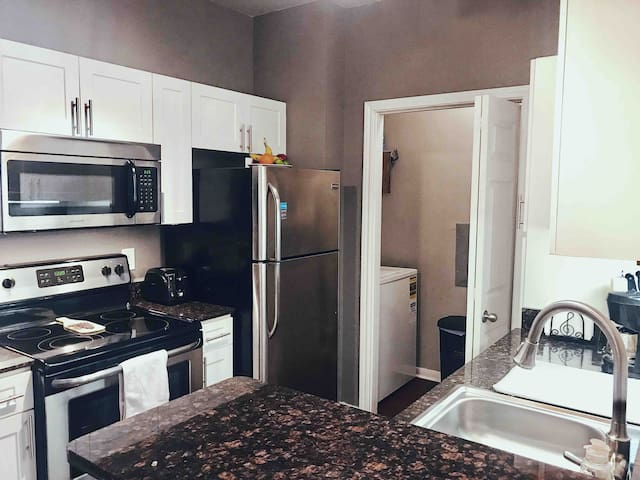 Kitchen & Personal Laundry Room - Laundry Room includes brand new full-size Washer and Dryer with adjustable settings great for washing all clothing types (delicates & normal clothing). Laundry detergent and all home cleaning supplies included.
