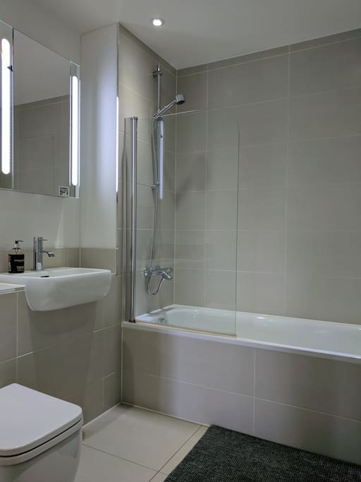 Bathroom with bathtub and lots of light