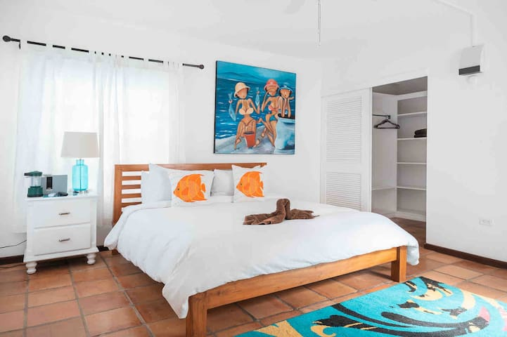 Queen size bed in one of the villas