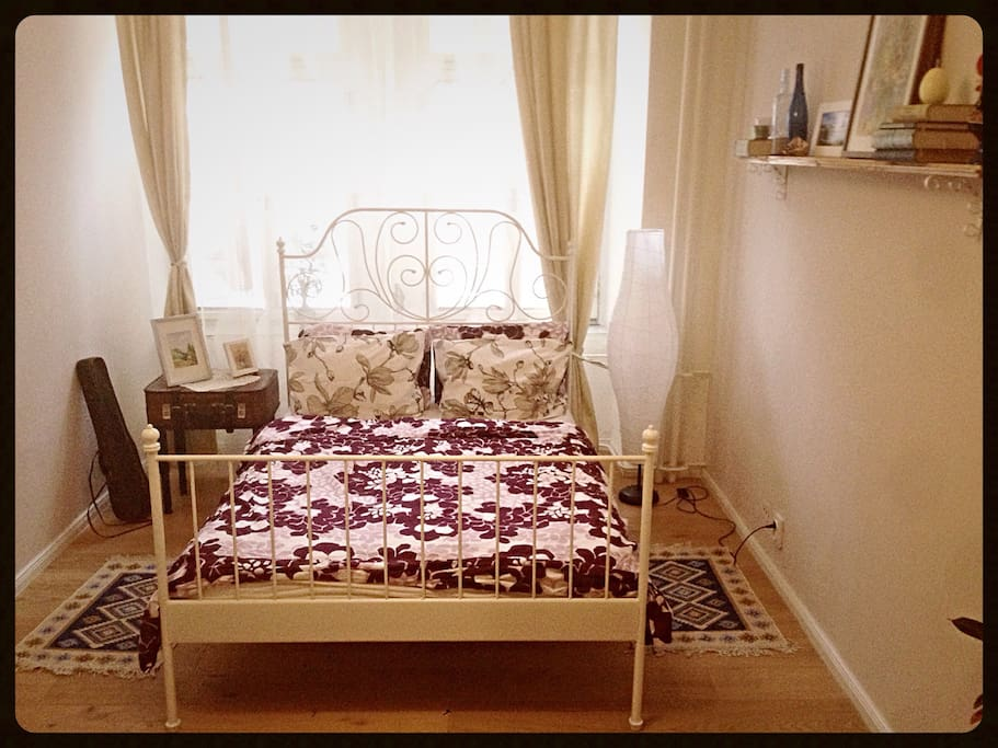 double bed in a 22 m2 room
