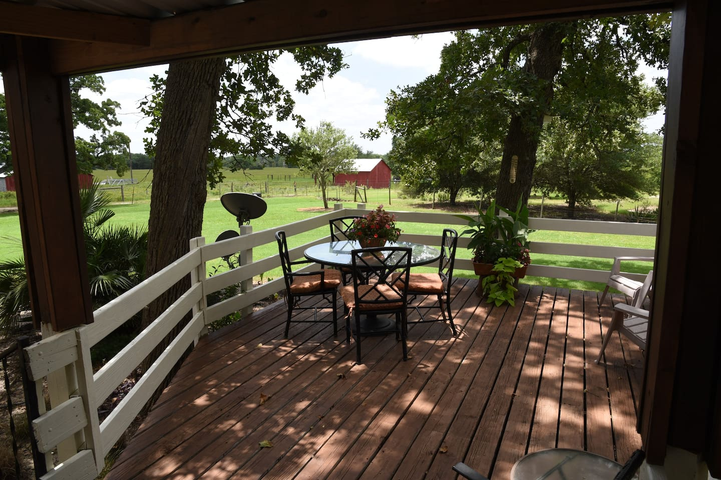 Chill out on the  back deck overlooking the 100 year old farmstead!