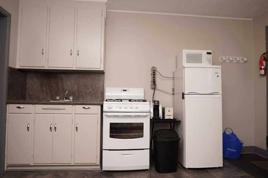 Full kitchen with gas range, Keurig coffee maker, fridge, microwave, dishes, pots & pans, cutlery, etc.