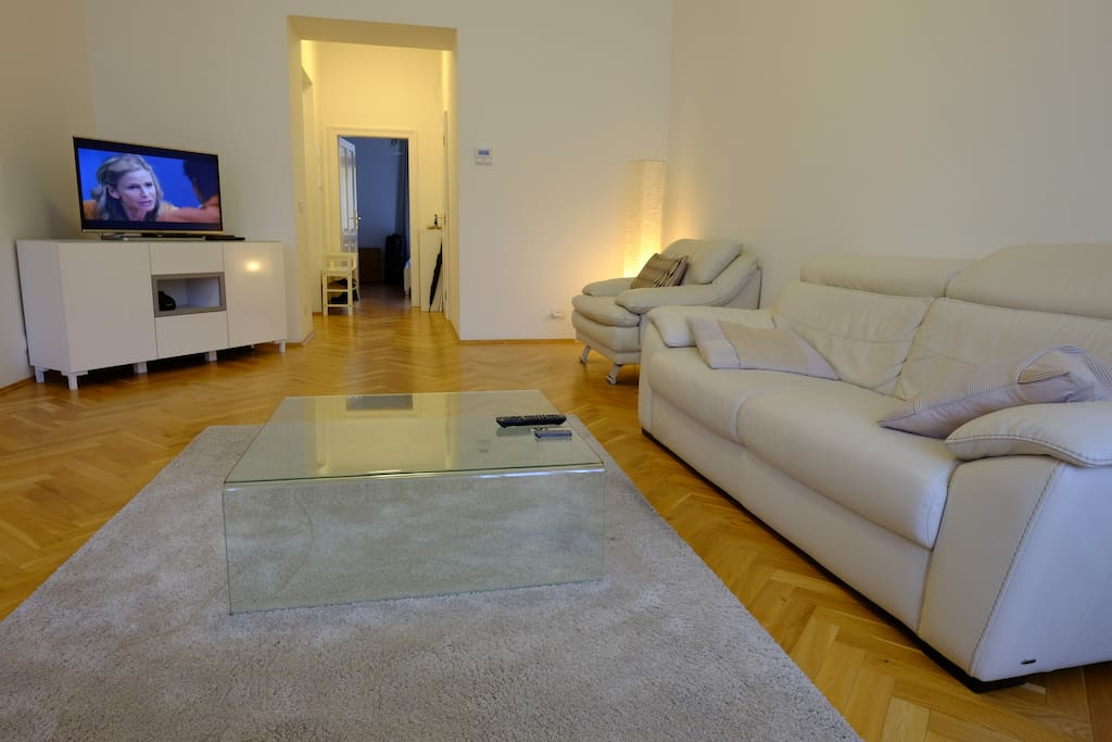 Spacious and modern living room with flat screen TV and stereo