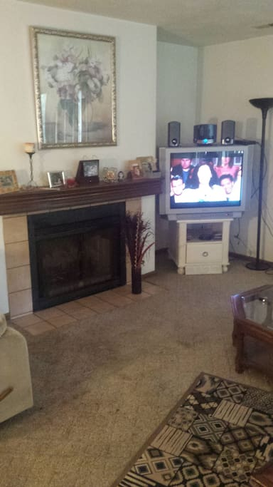 Living room, tv, and fireplace