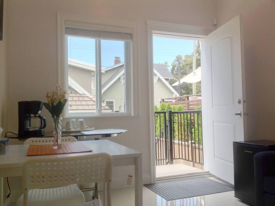 Living area with coffee machine, mini fridge and microwave.