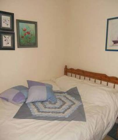 Double bedroom with private shower and WC, TV,A/C coffee maker,
