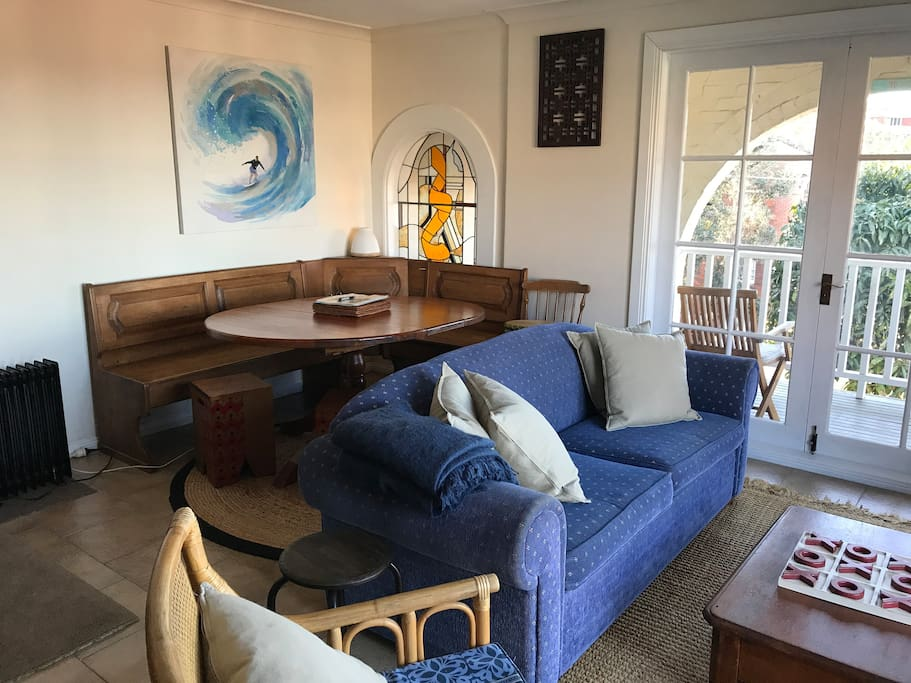 Your living area with lounge, Smart TV, DVD and free wifi laptop. Opens up to your two balcony's through the double french doors with views to the beach and ocean.