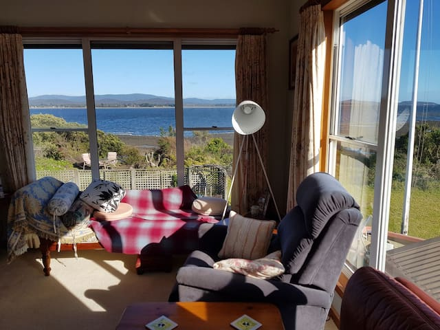 John's place by the river with beach and sea views