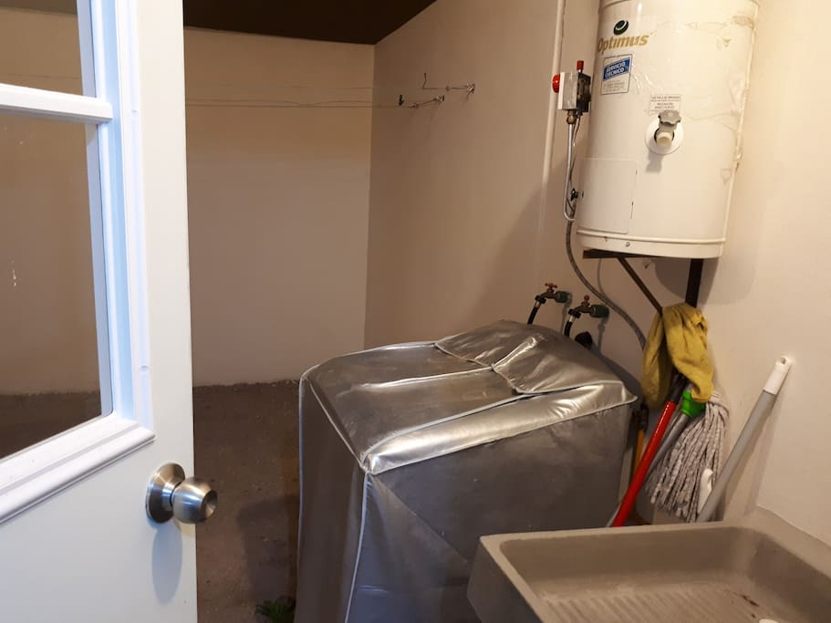 Lavadora y tendederos