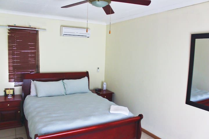 Master bedroom 1, with ensuite bathroom and air conditioning plus TV.