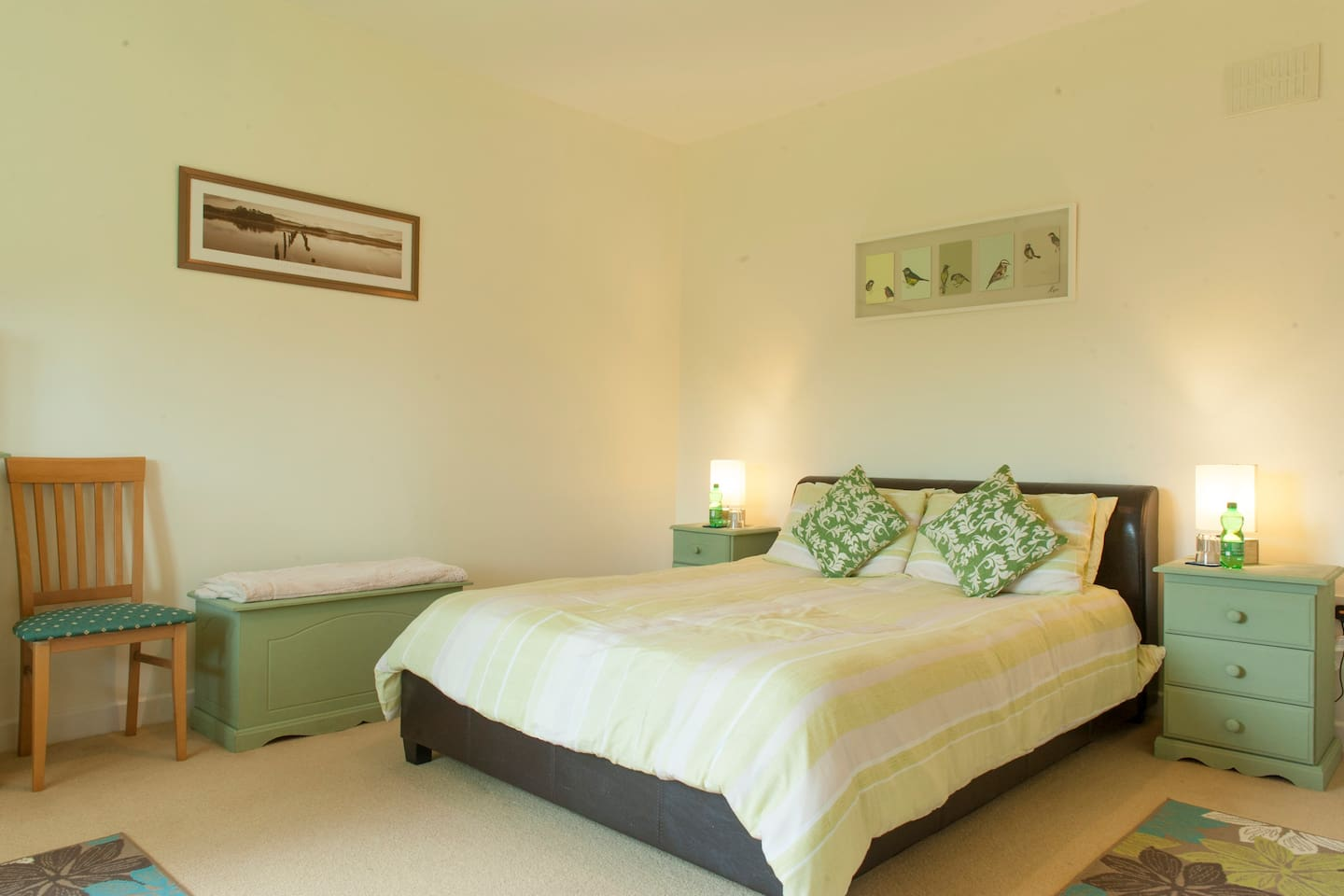 A large airy bedroom with a comfy king size bed