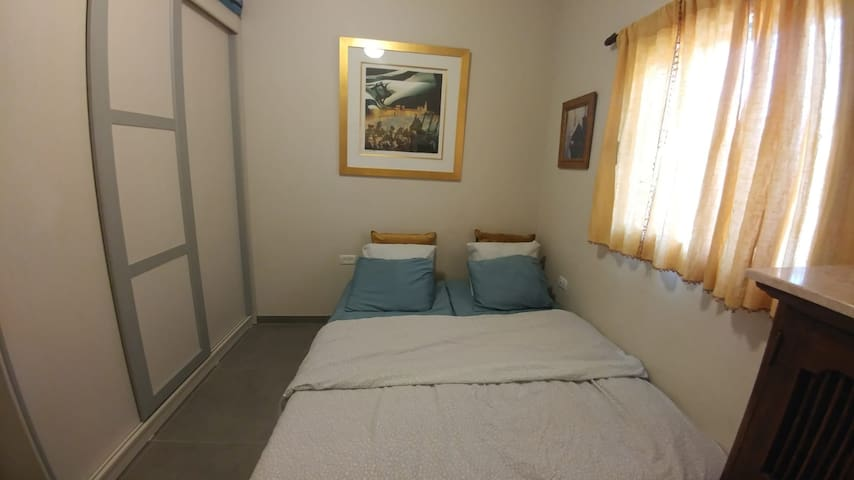 Bedroom with 2 single beds on the main floor that can be separated or combined into a large Queen size (1.6x2.0).   Full bathroom with shower is situated just outside the door.