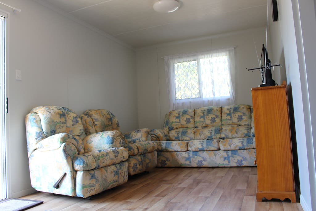 Lounge room features 2 single recliners and a 3 seter couch