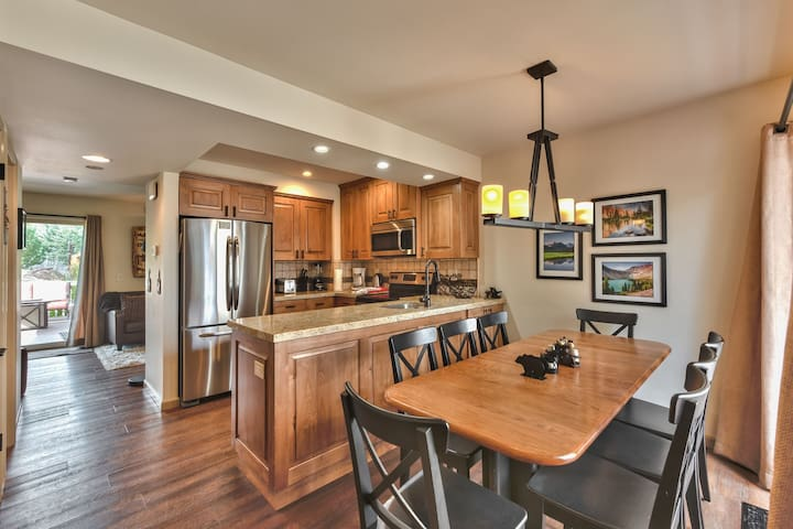 Entry into Dining Area, Kitchen and Living Room with Beautiful Hardwood Floors Throughout