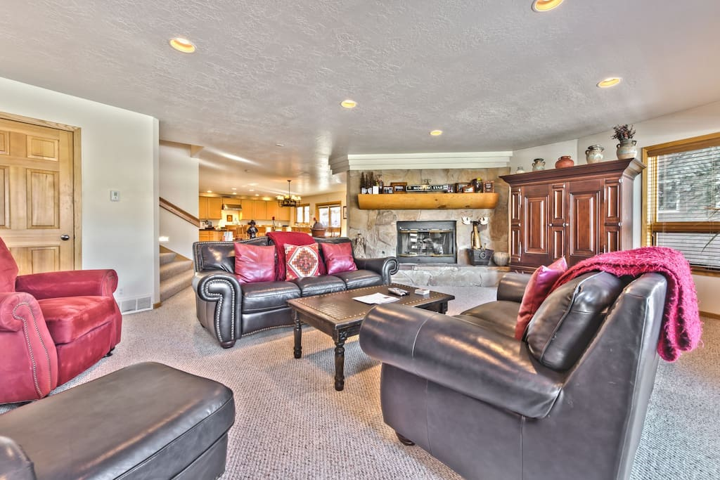 Living Room on Main Level with Flat Screen TV, DVD, Gas Fireplace, and Deck