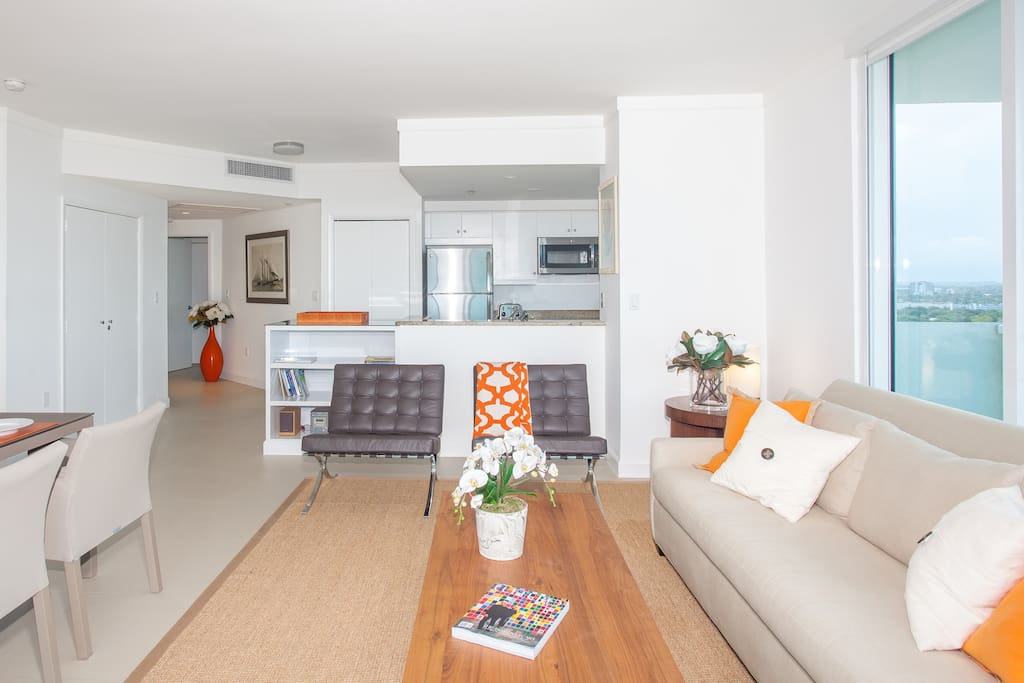 Plenty of light in a spacious condo, with  open kitchen.