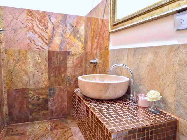 Room No. 5 Pink marble basin and marble shower area